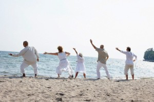 People on Beach Doing Tai Chi